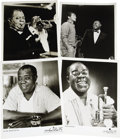 "Music Memorabilia:Photos, Louis Armstrong Vintage Press Photos. Set of four b&w 8"" x 10""press kit photos of Satchmo, circa 1966. In Excellent conditi...(Total: 1 Item)"