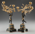 Decorative Arts, Continental, A PAIR OF LOUIS XV-STYLE BRONZE, GILT BRONZE AND MARBLE THREE-LIGHTFAIRY CANDELABRA, early 20th century. 13-1/8 inches high... (Total:2 Items)