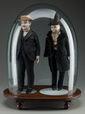 Decorative Arts, Continental, TWO VICTORIAN GENTLEMAN DOLLS UNDER A GLASS DOME AND CARVED WOODBASE, circa 1900. 18 inches high (45.7 cm) (dolls without b...(Total: 4 Items)