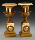 Decorative Arts, French, A PAIR OF EMPIRE-STYLE GILT METAL URNS ON PEDESTALS. 13-5/8 incheshigh (34.6 cm). ... (Total: 2 Items)