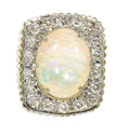 Estate Jewelry:Rings, Opal, Diamond, Gold Ring. The ring centers an oval-shaped opalcabochon measuring approximately 16.00 x 11.50 x 5.00 mm an...