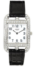"Timepieces:Wristwatch, Hermés, Lady's ""Cape Cod"" Diamond, Mother-of-Pearl, White Gold,Leather Strap Wristwatch, Modern. Case: 23 mm, 18k white g..."