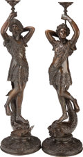 Decorative Arts, Continental, A LARGE PAIR OF CONTINENTAL BRONZE FIGURAL CANDLESTICKS, 19thcentury. 58-1/4 inches high (148.0 cm) (taller). ... (Total: 2Items)