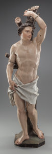 Decorative Arts, Continental, AN ITALIAN CARVED POLYCHROME WOOD FIGURE OF SAINT SEBASTIAN,Probably Tuscan, early 18th century. 40 inches high (101.6 cm)...
