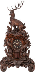 Clocks & Mechanical:Clocks, A LARGE BLACK FOREST CARVED WOOD AND IVORY MANTLE CLOCK, 19th century. 57-3/4 x 27 x 15 inches (146.7 x 68.6 x 38.1 cm). ...