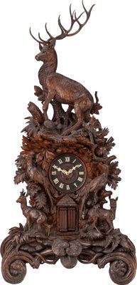 A LARGE BLACK FOREST CARVED WOOD AND IVORY MANTLE CLOCK, 19th century 57-3/4 x 27 x 15 inches (146.7 x 68.6 x 38.1