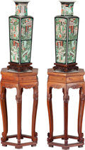 Asian:Chinese, A PAIR OF CHINESE FAMILLE NOIRE DOUBLE-WALLED ENAMELED PORCELAINVASE ON CARVED WOOD STANDS, late Qing dynasty. Marks: (six-...(Total: 4 Items)
