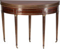 Furniture : French, A FRENCH NEOCLASSICAL MAHOGANY AND BRASS DEMILUNE DOUBLE FLIP-TOPGAMES TABLE, 19th century. 29 inches high x 42 inches diam...