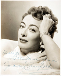 [Featured Lot]. Joan Crawford Inscribed Photograph. Sepia-toned publicity photograph depicting Oscar-winni