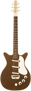 Musical Instruments:Electric Guitars, Circa 1961 Danelectro Deluxe Walnut Solid Body Electric Guitar....