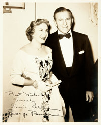 [Featured Lot]. Gracie Allen and George Burns Inscribed Photograph. Sepia-toned publicity photograph depicting comedy