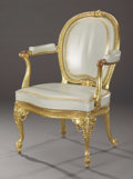 Furniture : English, A George III Giltwood Armchair. Attributed to Thomas Chippendale, London, England. Circa 1770. Giltwood, leather. Marks: n...