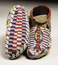 American Indian Art:Beadwork, A PAIR OF SIOUX BEADED HIDE CEREMONIAL MOCCASINS. c. 1890...