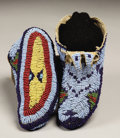 American Indian Art:Beadwork, A PAIR OF SIOUX CHILD'S BEADED HIDE CEREMONIAL MOCCASINS. c. 1880...