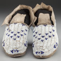 American Indian Art:Beadwork and Quillwork, A Pair of Cheyenne Beaded Hide Moccasins . c. 1880... (Total: 2 )