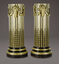 A PAIR OF FRENCH EBONY AND GILT WOOD PEDESTALS Paris, France, Early 19th Century 58 inches (147.3 cm) high, eac
