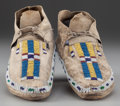 American Indian Art:Beadwork and Quillwork, A Pair of Cheyenne Beaded Hide Moccasins ... (Total: 2 Items)