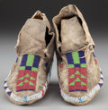American Indian Art:Beadwork and Quillwork, A Pair of Sioux Beaded Hide Moccasins ... (Total: 2 Items)