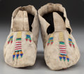 American Indian Art:Beadwork and Quillwork, A Pair of Plains Beaded Hide Moccasins . Possibly Cheyenne...(Total: 2 Items)