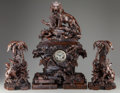 Decorative Arts, Continental:Other , Three Piece Black Forest Carved Figural Clock Garniture: Lionswithin Ruins, 19th century. 30 inches high, tallest (76.2 cm)...(Total: 3 Items)