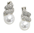 Estate Jewelry:Earrings, South Sea Cultured Pearl, Diamond, Platinum Earrings. Each earringis highlighted by a white South Sea cultured pearl meas...