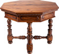 Furniture : Continental, An Italian Renaissance-Style Walnut Octagonal Table, 19th century.31-1/2 inches high x 41 inches diameter (80.0 x 104.1 cm)...