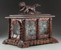 Decorative Arts, Continental, A Black Forest Carved Wood and Glass Tantalus, circa 1880. 16-1/2inches high x 18-1/4 inches wide x 13-3/4 inches deep (41....(Total: 21 Items)