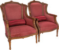 Furniture : French, A Pair of Louis XV-Style Upholstered Walnut Bergères with BolsterCushions, late 19th century. 40-1/2 inches high x 28-1/2 i...(Total: 2 Items)