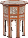 Furniture : Continental, A Moorish Fruitwood, Ebony and Mother-of-Pearl Side Table, 20thcentury. 19-1/8 inches high x 15-1/2 inches diameter (48.6 x...