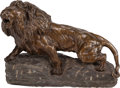 Sculpture, After Thomas François Cartier (French, 20th Century). Lion Rugissant sur son Rocher. Bronze with brown patina. 12 inches...
