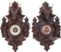 Decorative Arts, Continental:Other , A Black Forest Figural Barometer and Clock Set, 19th century. 36inches high x 21 inches wide (91.4 x 53.3 cm). ... (Total: 2 Items)