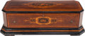 Decorative Arts, Continental:Other , A Swiss Inlaid and Ebonized Rosewood Music Box, 19th century.10-1/2 inches high x 36 inches wide x 15 inches deep (26.7 x 9...(Total: 2 Items)