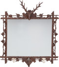 Decorative Arts, Continental:Other , A Pair of German Black Forest-Style Walnut Mirrors with Stag andBoar Mounts, 20th century. 46 inches high x 41 inches wide ...(Total: 2 Items)