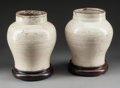 Asian:Chinese, A Pair of Chinese White Glazed Porcelain Vases on Stands. 7-1/2inches high (19.1 cm) (vase). ... (Total: 2 Items)