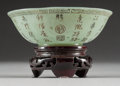 "Asian:Chinese, A Chinese ""Jade"" Bowl with Poetic Prose on a Carved Hardwood Stand.Marks: (four-character mark). 3-1/8 inches high (7.9 cm)..."