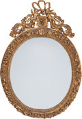 Decorative Arts, French, A Napoleon III Giltwood Oval Wall Mirror, circa 1870. 45-1/2 incheshigh x 31 inches wide (115.6 x 78.7 cm). ...
