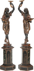 Decorative Arts, Continental, A Pair of Venetian Carved Polychrome Blackamoors on Pedestals, late 19th century. 72 inches high (182.9 cm). ... (Total: 2 Items)
