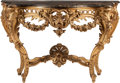 Furniture : Continental, A Italian Louis XV-Style Carved Giltwood Console with Black MarbleTop, 19th century. 34 inches high x 53-3/4 inches wide x ...
