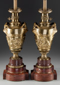Decorative Arts, French:Lamps & Lighting, A Pair of Gilt Bronze and Rouge Marble Urns with Satyr HandlesMounted as Lamp Bases, 20th century. 22 inches high (55.9 cm)...(Total: 2 Items)