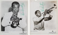 Music Memorabilia:Autographs and Signed Items, Louis Armstrong - Set Of Two Signed Promotional Photos....