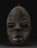 African: , Dan (We) (Liberia/Côte d'Ivoire). Face Mask. Wood, brass tacks,cloth, iron, nails. Height: 12 5/8 inches Width: 7 ¼ inches...