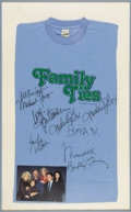 """Movie/TV Memorabilia:Autographs and Signed Items, """"Family Ties"""" Cast Signed T-Shirt. This light blue t-shirt isemblazoned with the logo for the popular '80s sitcom (which h..."""