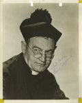 "Movie/TV Memorabilia:Autographs and Signed Items, Barry Fitzgerald Signed Photo. A vintage b&w 8"" x10"" photo of the actor in costume as a priest, signed by him in blue ballpo..."