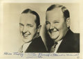 "Movie/TV Memorabilia:Autographs and Signed Items, Laurel and Hardy Signed Photo. This 7"" x 5"" b&w photo of comedyduo Stan Laurel and Oliver Hardy is inscribed ""Hello Jimmy!""..."