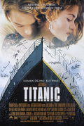 "Movie/TV Memorabilia:Autographs and Signed Items, ""Titanic"" Cast-Signed Photo. A 27"" x 39"" poster for therecord-breaking film signed by actors Leonardo DiCaprio, KateWinsl..."