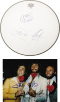 "Music Memorabilia:Autographs and Signed Items, Bee Gees Signed Photo and Drumhead. A Remo drumhead and color 8"" x10"" glossy photo, both signed by Barry, Robin, and Mauri..."