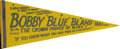 "Music Memorabilia:Posters, Bobby ""Blue"" Bland Pennant. A vintage blue-and-yellow pennant, 30""x 12"", touting ""The Crown Prince of the Blues."" In Very ..."