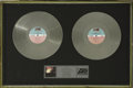 """Music Memorabilia:Awards, Ratt """"Out of the Cellar"""" Double-Platinum Award. Presented to Rainbow Bar and Grill (on the Sunset Strip) to commemorate the ..."""