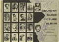 """Music Memorabilia:Autographs and Signed Items, Country Music Picture Album Signed by Elvis and Others. This copyof the 1955 """"Country Music Picture Album"""" boasts a mighty..."""