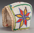 American Indian Art:Beadwork and Quillwork, A Sioux Girl's Beaded Hide Bonnet. c. 1900...